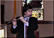 flutist performing in church